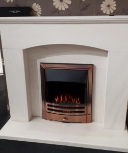 Solid Limestone Fireplace and Cast Electric Fire . Now Ex Display £990