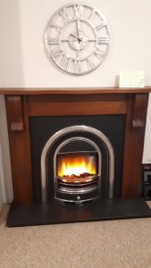 Cottage Walnut Mantel , tennyson cast , fire and hearth . Was £1955 NOW £999 Ex Display .