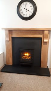 Solid Oak Cottage Mantel leathered effect Granite Set . Ignite Cast Electric Inset Stove . Was £1868 NOW £1100